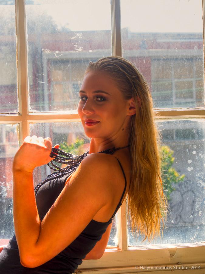 Chloe in the window's light